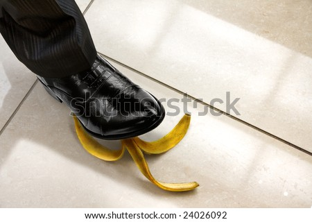men shoe stepping on banana peel, top view. Look for more in MY PORTFOLIO