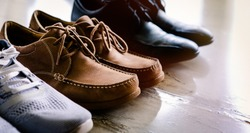 Men shoes that usually use everyday.are black one, brown and sport wear.