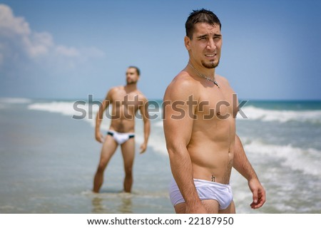 Men standing at the beach