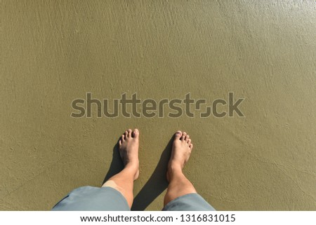 Men Stomping  on the sand on the beach.Feet walking through waves on the beach.