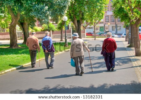 men strolling through a park