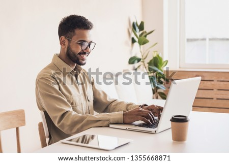 Men student working on computer. Businessman using laptop at home. Internet marketing, freelance work, working at home, online learning, studying, lockdown concept. Distance education
