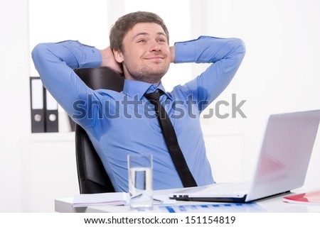 Men sweating. Thoughtful businessman sweating while sitting at his working place - stock photo