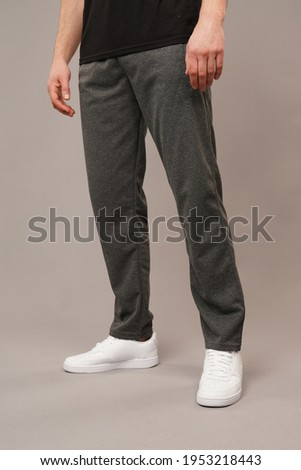 men track suit in front of grey background in studio Stock photo ©