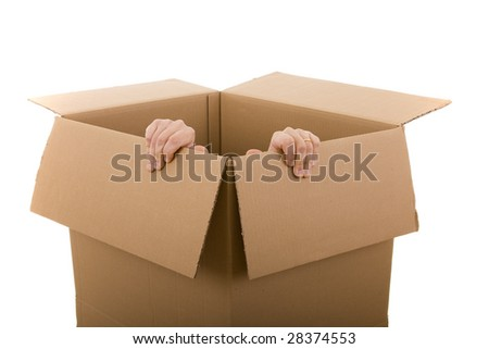 men trying to escape from a cardboard box (selective focus)