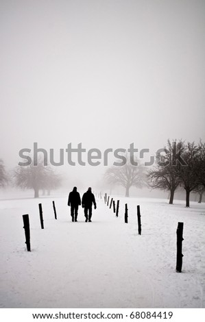 Men walking in a winter landscape