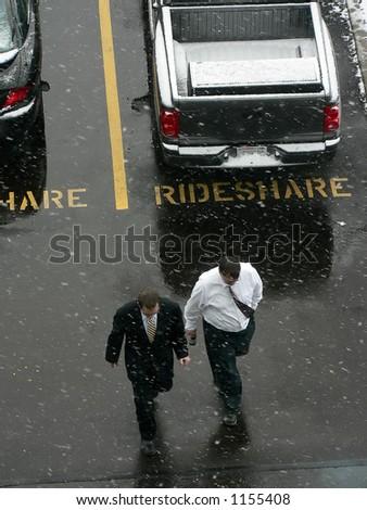 Men walking in parking lot
