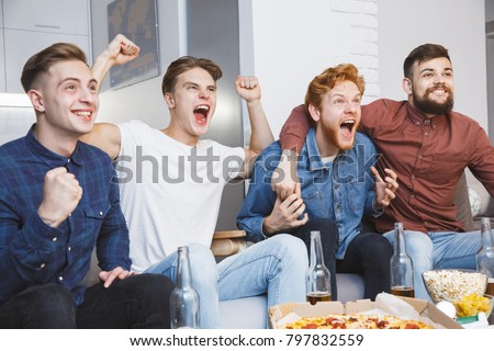 Men watching sport on tv together at home screaming cheerful #797832559