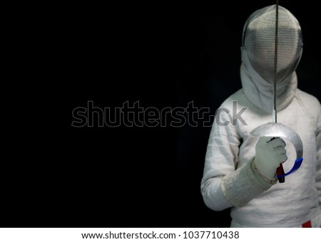 Men wearing a universal fencing sabre athlete on a black background are pretending to be crest.