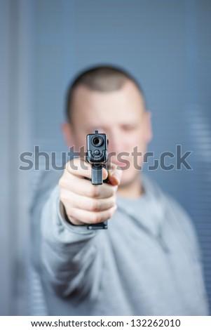men with handgun close up