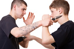 Men with knifes, martial fighting.