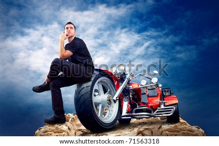 Men with motorbike on the top of mountains.