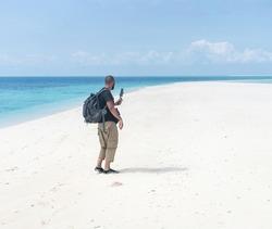 Men with smartphone camera filming beautiful beach