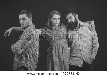 Men, woman on pensive faces, black background. Company of confident people, friends. Love triangle concept. Relations, communication, friendship, love, betrayal Men in checkered clothes retro style