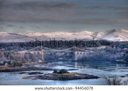 Menai Bridge in winter with Snow on the snowdonia National Park North Wales