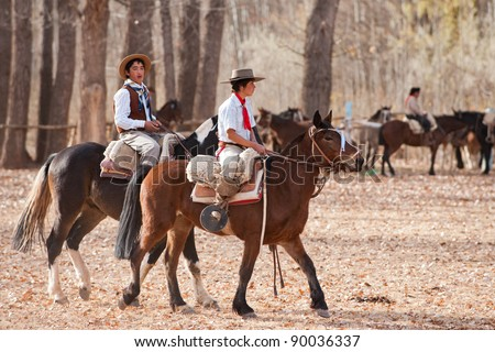 MENDOZA, ARGENTINA - MAY 25: Young Gauchos riding a horse in exhibitions for Argentina 200 hundreds years anniversary. May 25, 2010 in Mendoza, Argentina