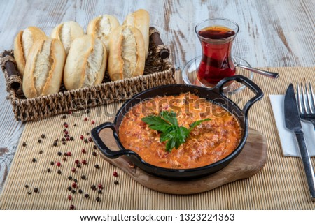 Menemen Turkish breakfast food egg, tomatoes and pepper in pan with concept background. Stok fotoğraf ©