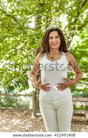 menopausal woman is happy because she lost the weight and now she has a flat stomach #452491408