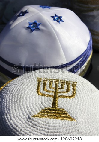 menorah - a symbol of Hanukkah, embroidered with gold thread on Jewish religious cap