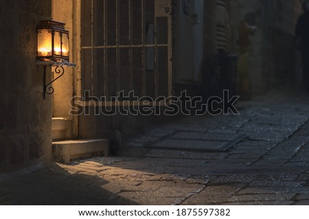 Menorah in a glass box - lit at the entrance to an ancient building in the Jewish Quarter in the Old City, Jerusalem, Israel Photo stock ©