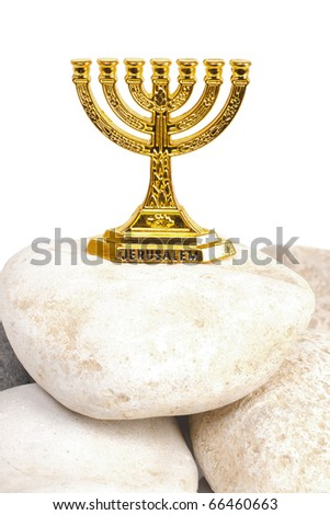 Menorah on a stone isolated on white background