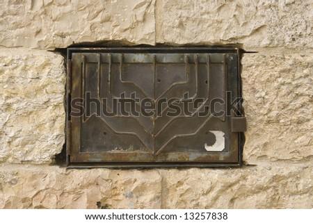 Menorah on a stone wall - stock photo