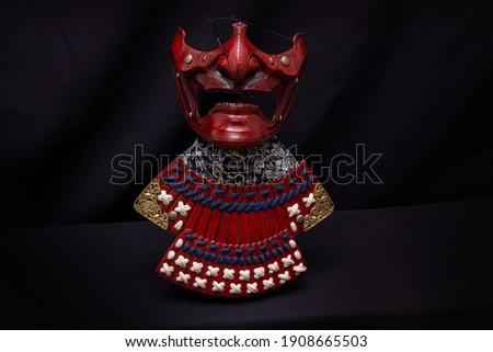 menpo samurai mask with a black background