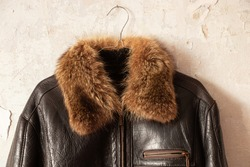 mens black leather winter jacket with fur collar close-up