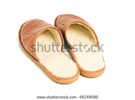 Mens brown leather slippers isolated over white - stock photo