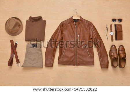 Mens clothing business set with various accessories on a wooden background, Top view, Photo stock ©