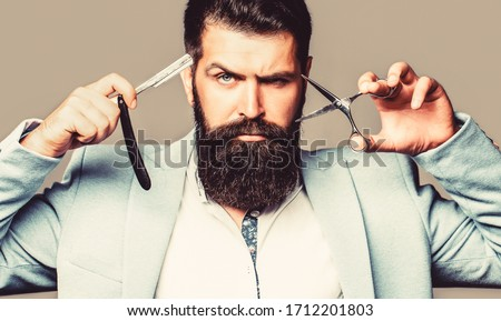 Mens haircut. Barber scissors and straight razor, barber shop Beard man, bearded male. Portrait beard man. Barber scissors and straight razor, barber shop, suit.
