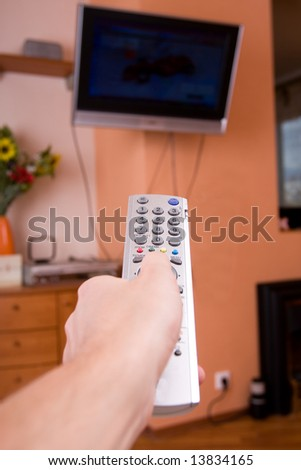 mens hand with remote control