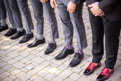 Mens shoes and socks standing in a row