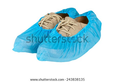 mens shoes in overshoes isolated on white background  #243838135