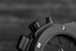 Mens watch, black wrist watch close-up. Clockwork mechanism. The best accessories for men.