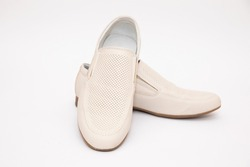 Mens white shoes on a white background