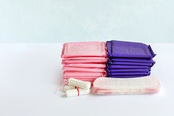 Menstruation cotton sanitary pads and tampons for women hygiene protection. Feminine hygiene. Soft tender protection for women critical days. Concept: gynecological menstruation cycle. Copy space