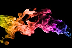ment of colorful smoke on black background. abstract background