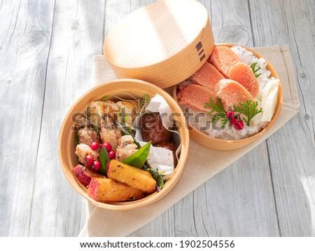 Mentaiko bento in a round wooden bento box