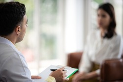Mental health concept, Close-up of psychologist comforting his depressed patient, Doctor (psychiatrist) consultation and diagnostic examining woman patient