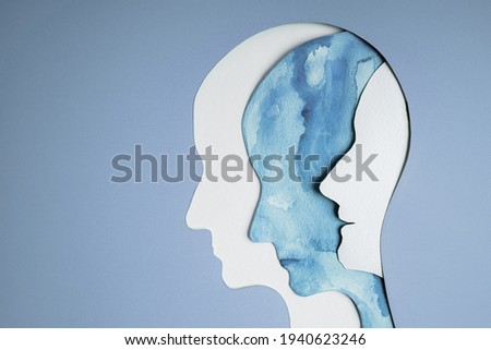 Mental Health Disorder Concept. Bipolar Disorder Person. Unstable Psycho. Layers of Paper Cut as Human Head presenting Different of Emotions. Happiness and Depression Emotion inside