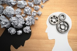 Mental health image. Silhouette of depressed person brain and healthy person brain. Waste paper, gears and head silhouette.