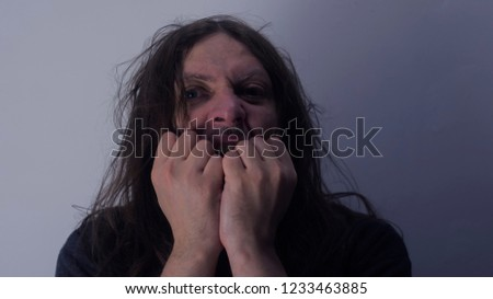 Mental health photo. Illustration of depression and psychosis. Mental health photo. Illustration of depression and psychosis. The man screams and goes mad.