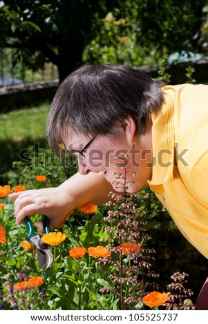 mentally disabled woman cut flowers in the garden