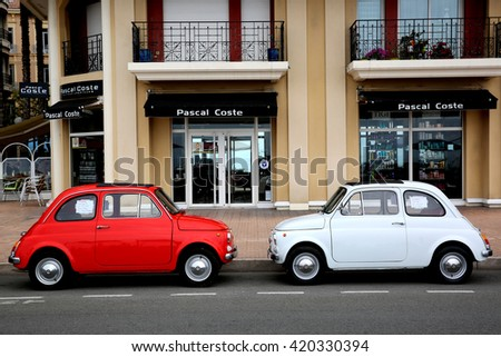 "stock photo menton france may two small italian cars fiat parked in a parking lot in menton 420330394 - Каталог - Фотообои ""Автомобили"""