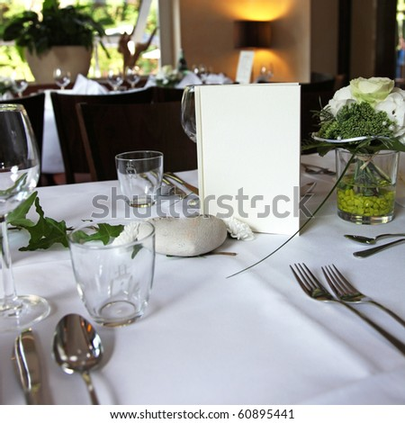 menu card on an elegantly set table in the restaurant