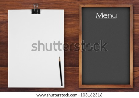 menu chalkboard with notepaper on wooden background