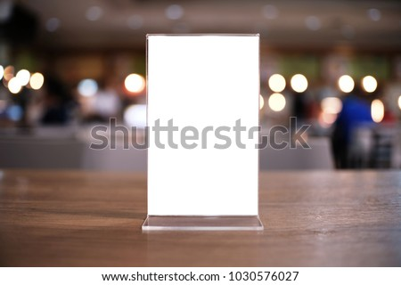 Menu frame standing on wood table in Bar restaurant cafe. space for text marketing promotion #1030576027