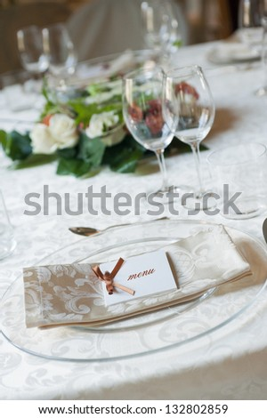 menu on plate on restaurant table