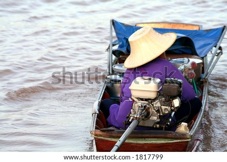Merchant in a Long tail boat in Chaopraya river, Thailand